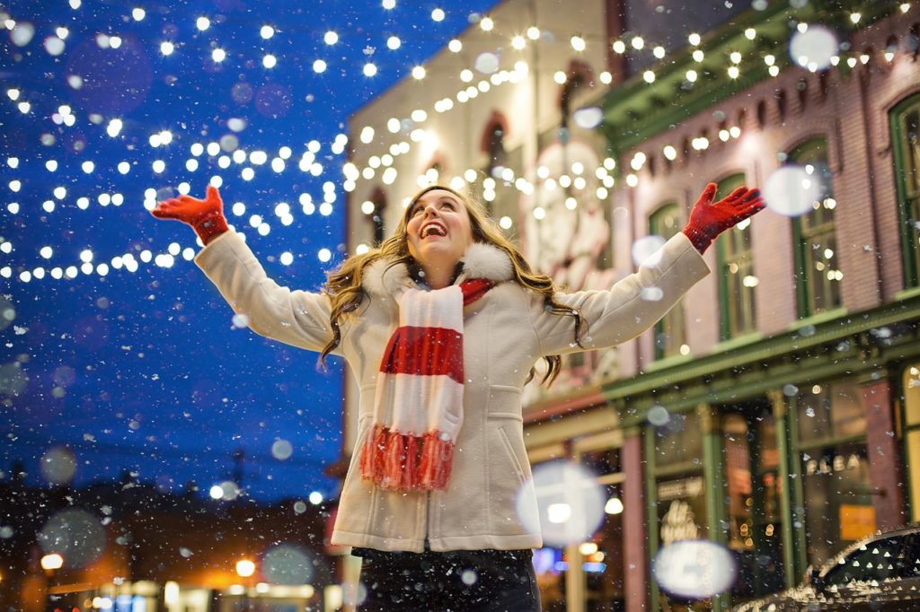 woman enjoying christmas lights