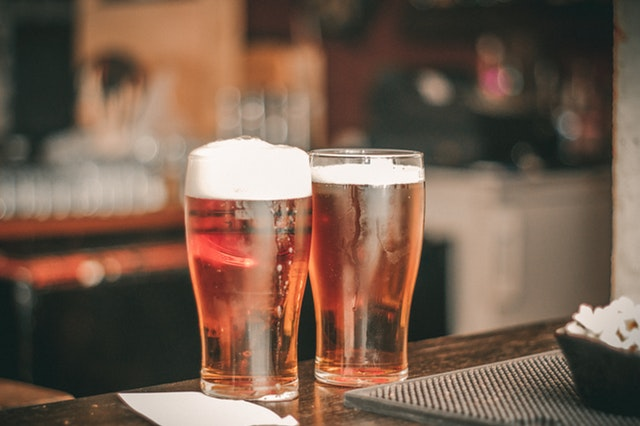 two beer glasses in a brewery