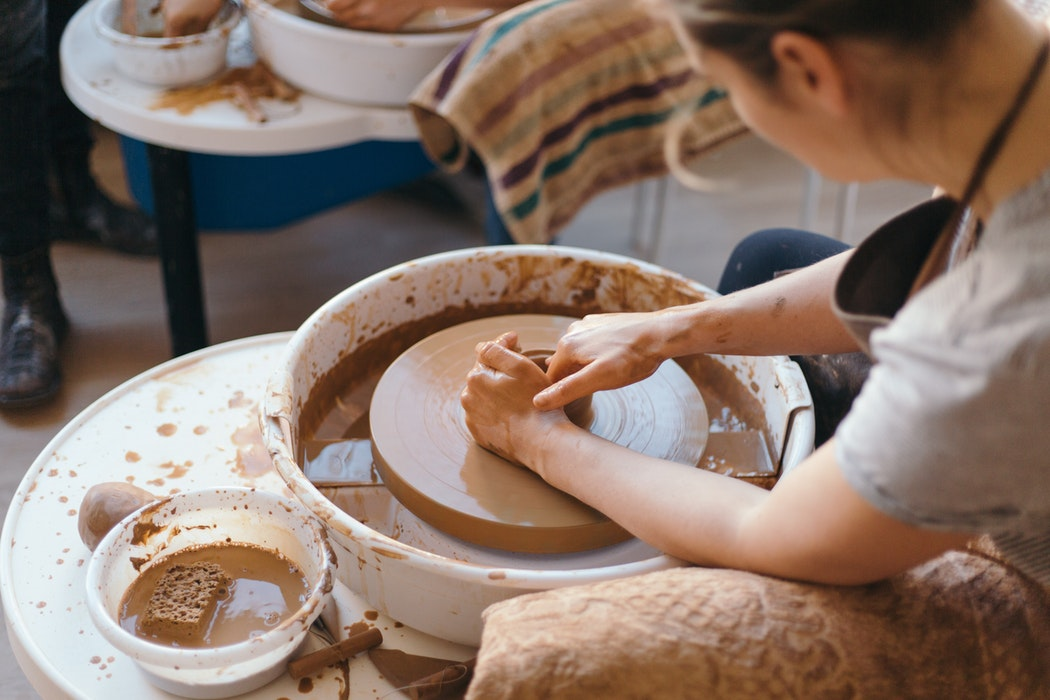 A person doing pottery.