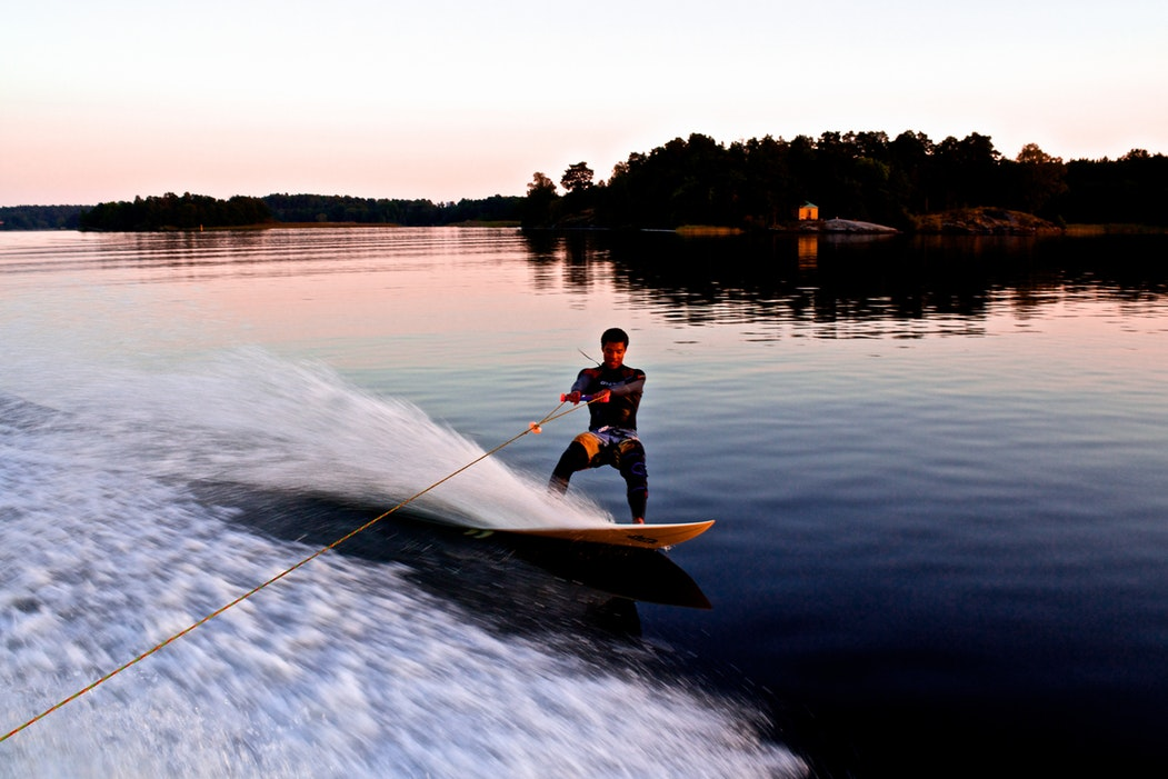 A person waterskiing on a lake.