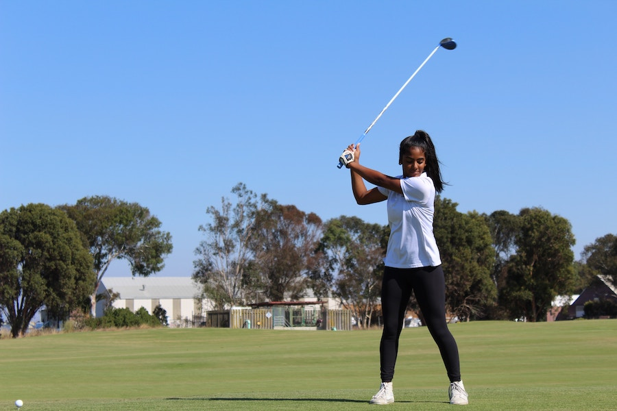 Woman learning to golf