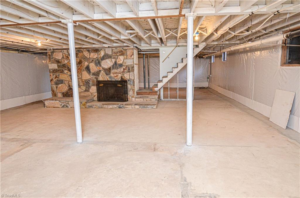 Unfinished basement with fireplace