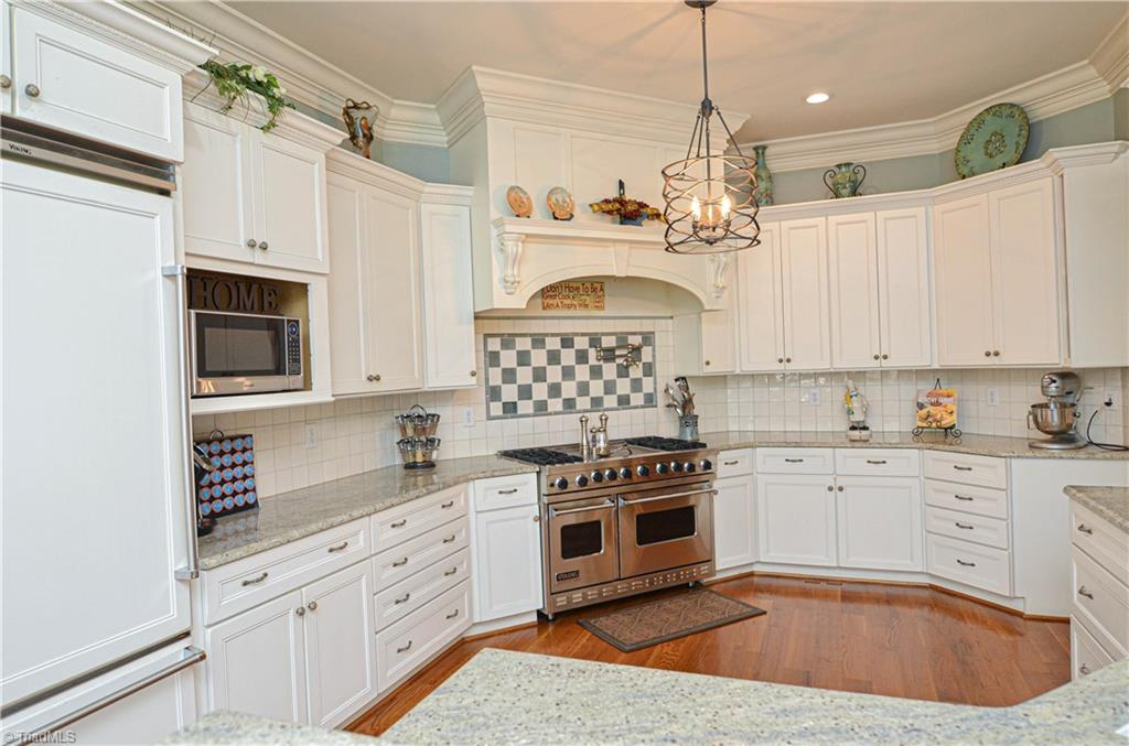 Kitchen with light cabinets